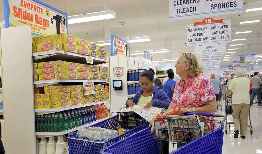 Irasema Subervi, left, and Margaret Kenny, both of New Fairfield, shop at the just-opened Shoprite at the North Street Street Shopping Center Wednesday, August 3, 2016. The store held its grand opening Wednesday morning. Photo: Carol Kaliff / Hearst Connecticut Media / The News-Times
