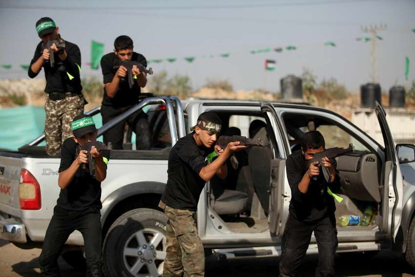 GAZA CITY, GAZA - JULY 20: Palestinian youth attend military summer training camp organized by Hamas in Gaza City, Gaza on July 20, 2016. (Photo by Ashraf Amra/Anadolu Agency/Getty Images)