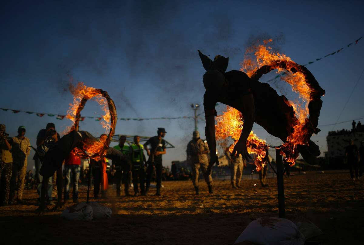 Palestinian youth show their skills during a graduation ceremony as part of a military-style summer camp organised by Hamas in Gaza City, on July 22, 2016. / AFP / MOHAMMED ABED (Photo credit should read MOHAMMED ABED/AFP/Getty Images)