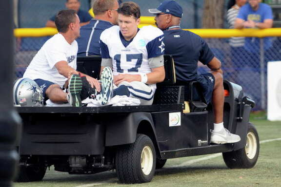 Dallas Cowboys quarterback Kellen Moore (17) is carted off the field after an ankle injury during the afternoon practice at the team's training camp in Oxnard, Calif., n Tuesday, Aug. 2, 2016. (Max Faulkner/Fort Worth Star-Telegram/TNS)