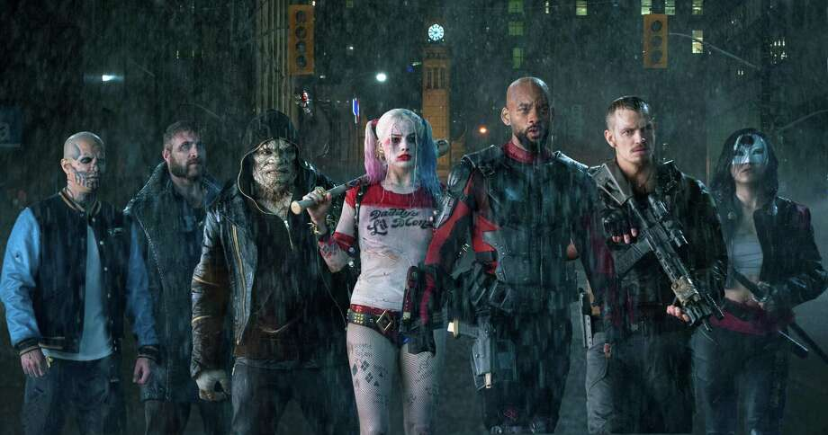 "This image released by Warner Bros. Pictures shows the ""Suicide Squad"" cast: from left, Jay Hernandez as Diablo, Jai Courtney as Boomerang, Adewale Akinnuoye-Agbaje as Killer Croc, Margot Robbie as Harley Quinn, Will Smith as Deadshot, Joel Kinnaman as Rick Flag and Karen Fukuhara as Katana. Photo: Clay Enos / Warner Bros. Pictures"