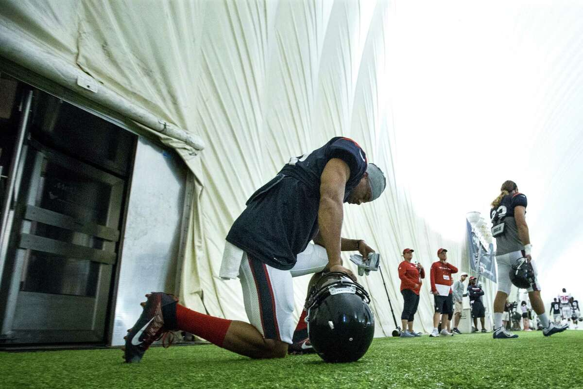 Houston Texans wide receiver Cecil Shorts (18) takes a knee as he walks onto the pratice field during Texans training camp at Houston Methodist Training Center on Wednesday, Aug. 3, 2016, in Houston.