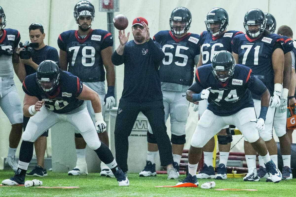 Houston Texans center Tony Bergstrom (68) and tackle Chris Clark (74) run a blocking drill during Texans training camp at Houston Methodist Training Center on Wednesday, Aug. 3, 2016, in Houston.