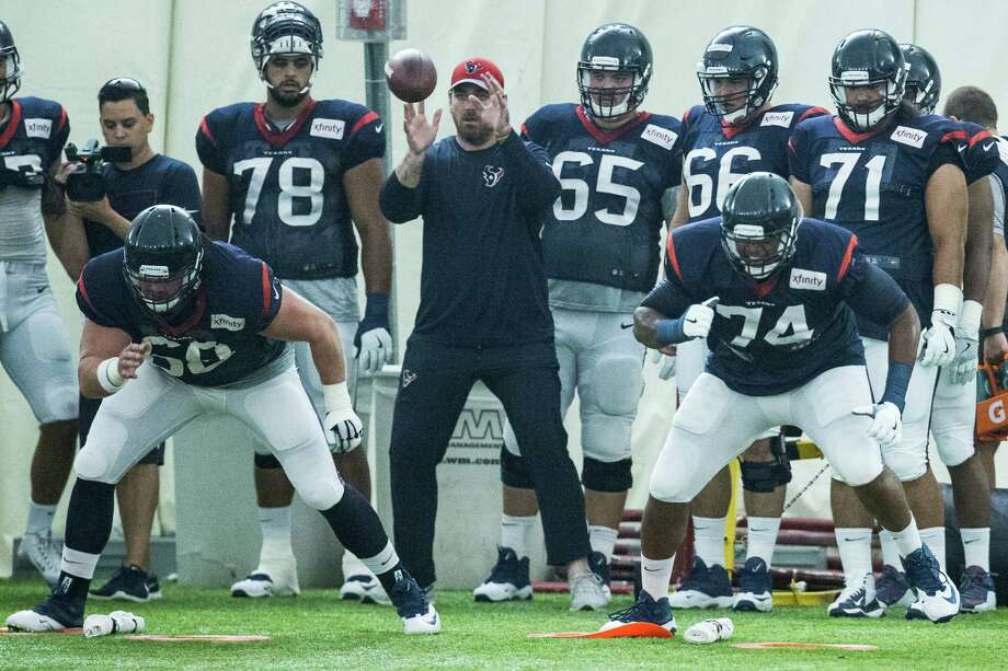 Houston Texans center Tony Bergstrom (68) and tackle Chris Clark (74) run a blocking drill during Texans training camp at Houston Methodist Training Center on Wednesday, Aug. 3, 2016, in Houston. Photo: Brett Coomer, Houston Chronicle / © 2016 Houston Chronicle