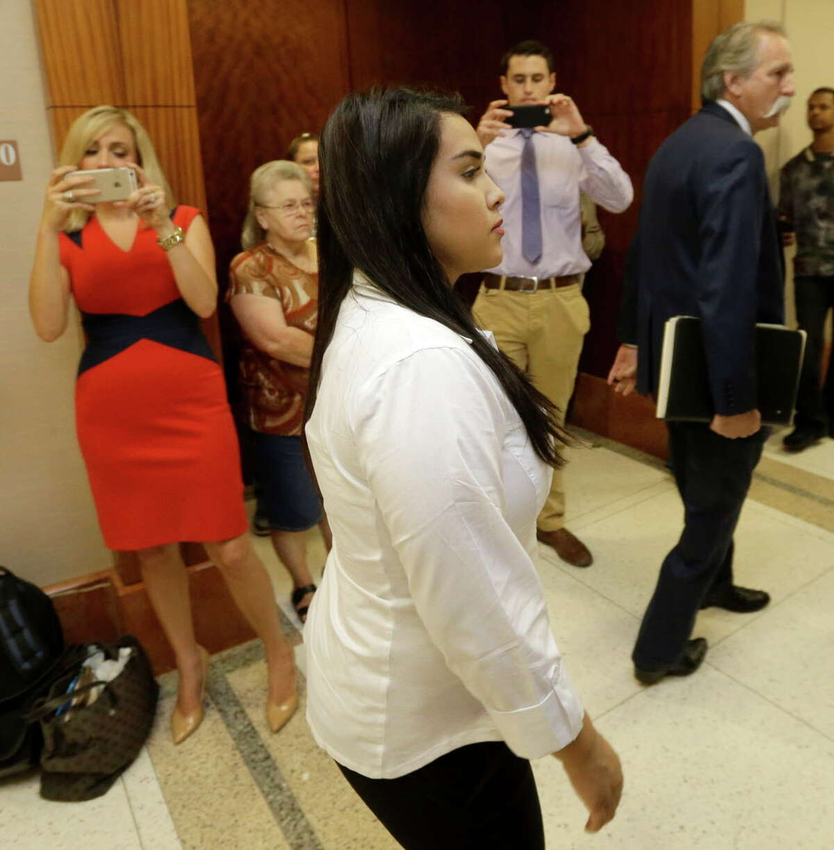 Alexandria Vera, 24, a former Aldine ISD teacher, arrives for court Wednesday, Aug. 3, 2016, in Houston. She is accused of having a long-term sexual relationship with a 13-year-old boy. State District Judge Michael McSpadden rejected a request from prosecutors that Vera's bail be revoked for a curfew violation. Vera is free on a $100,000 bail but has to wear a GPS ankle monitor, stay away from schools and have no contact with the teen who allegedly impregnated her.