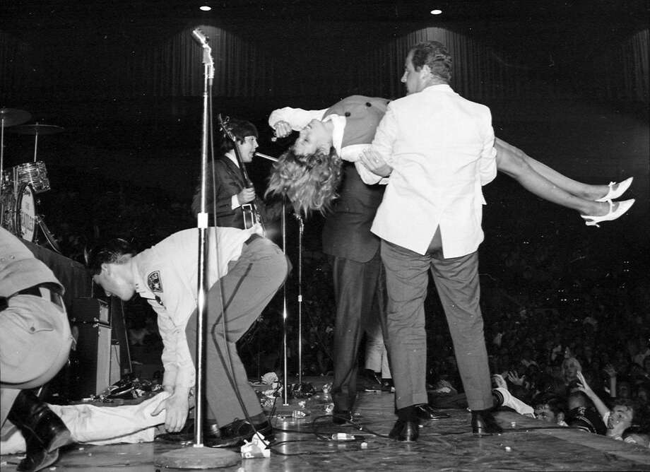 The Beatles play the Cow Palace on Aug. 31, 1965. Security had to carry fainting girls off the stage. Photo: Art Frisch, The Chronicle 1965