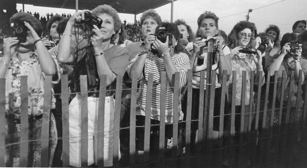 Fans of The Judds crush up against the restraining fence to get photographs of the country duet. August 1991