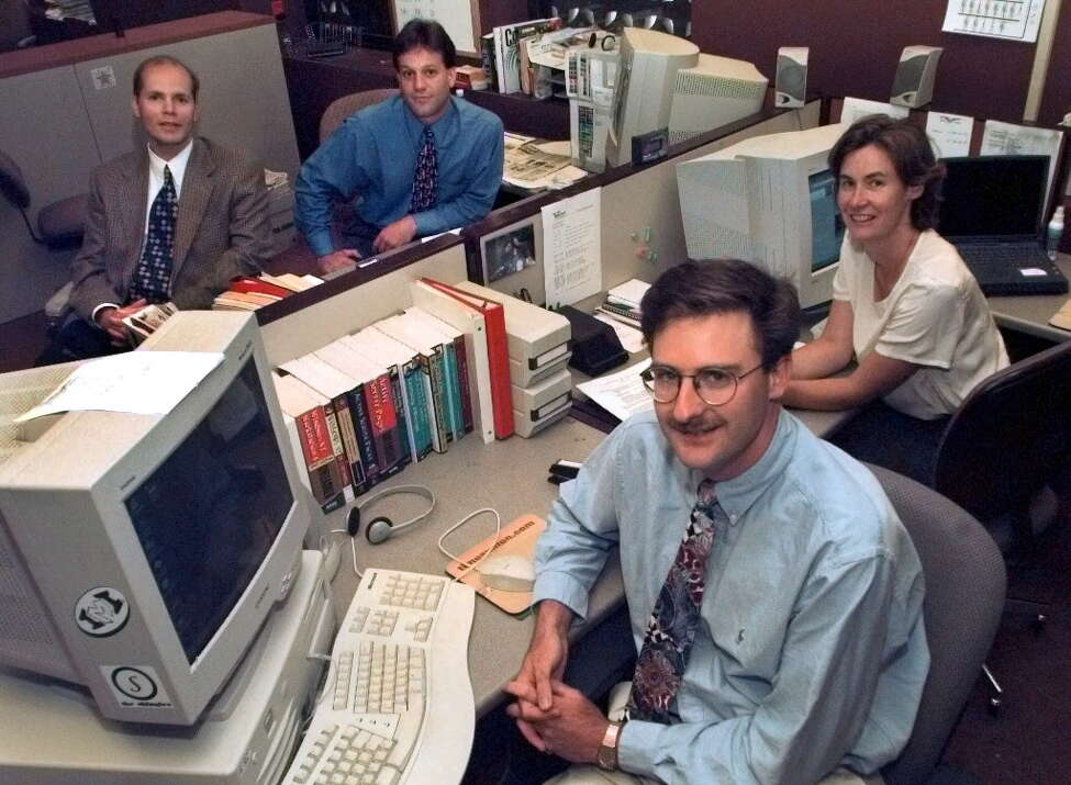 The timesunion.com team at their desks at the Times Union newspaper in Albany, NY, on July 15, 1999. Clockwise from left, Michael Huber, Bob Mckeon, Patti Hart and David Washburn. (Lori Kane / Times Union)