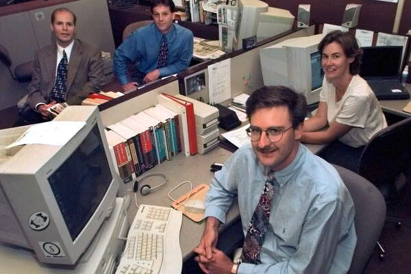 Times Union Photo by Lori Kane -- The 'timesunion.com' team at their desk at the Times Union newspaper in Albany, NY on Thrusday, July 15, 1999. From left, clockwise, Michael Huber, Bob Mckeon, Patti Hart and David Washburn.