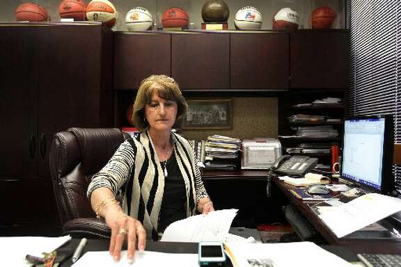 Lynn Hickey, Athletic Director at University of Texas San Antonio, prepares for a staff meeting. Hickey graduated from college the year after Title IX was passed, and has spent her entire coaching and administration career seeing the law's growth and effects. Wednesday. June 13, 2012.
