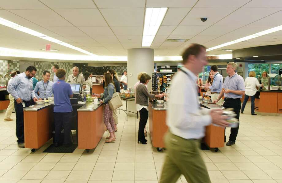 Employees pay for their food in the cafeteria at the Synchrony Financial headquarters in Stamford, Conn. Tuesday, Aug. 2, 2016. Synchrony's fitness center, which opened in January 2016, health center, which opened in December 2015, and revamped cafeteria are key parts of its Health 360 program. Photo: Tyler Sizemore / Hearst Connecticut Media / Greenwich Time