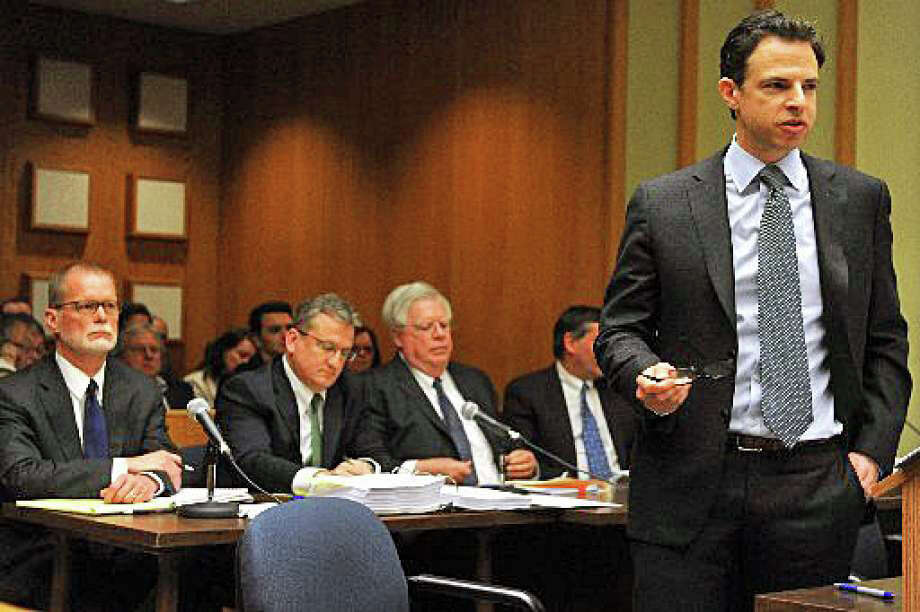 Joshua Koskoff, foreground, who represents Sandy Hook families suing Remington Arms, and attorneys for the gunmaker in Bridgeport Superior Court. Photo: / Ned Gerard