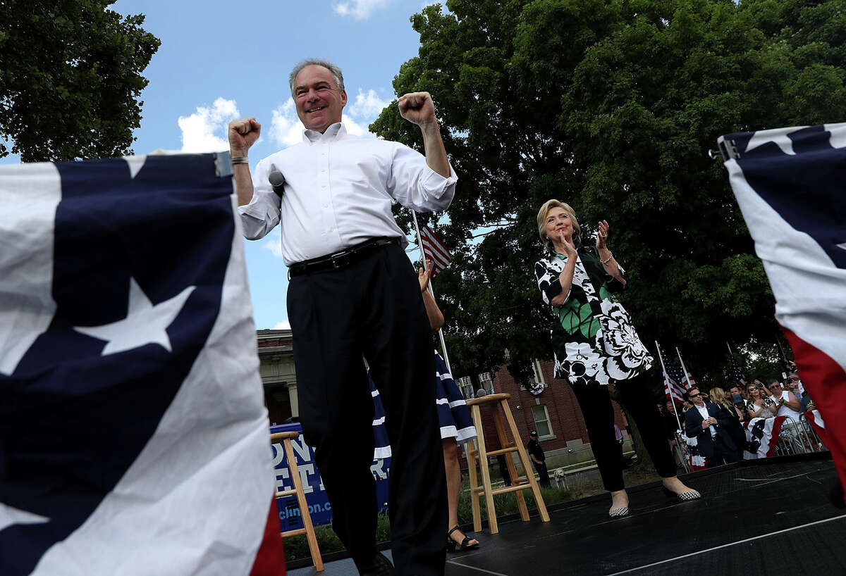 COLUMBUS, OH - JULY 31: Democratic presidential nominee former Secretary of State Hillary Clinton democratic vice presidential nominee U.S. Sen Tim Kaine (D-VA) greet supporters during a campaign rally at Fort Hayes Vocational School on July 31, 2016 in Columbus, Ohio. Hillary Clinton and Tim Kaine are wrapping up their three-day bus tour through Pennsylvania and Ohio. (Photo by Justin Sullivan/Getty Images)