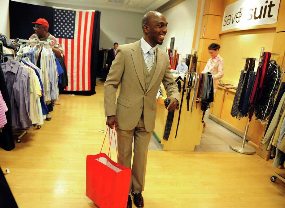 Veteran Marquis Smith, of Bridgeport, leaves in his new suit during a one-day event held by the Save a Suit Foundation in 2012. (File photo) Photo: Autumn Driscoll / Autumn Driscoll / Connecticut Post
