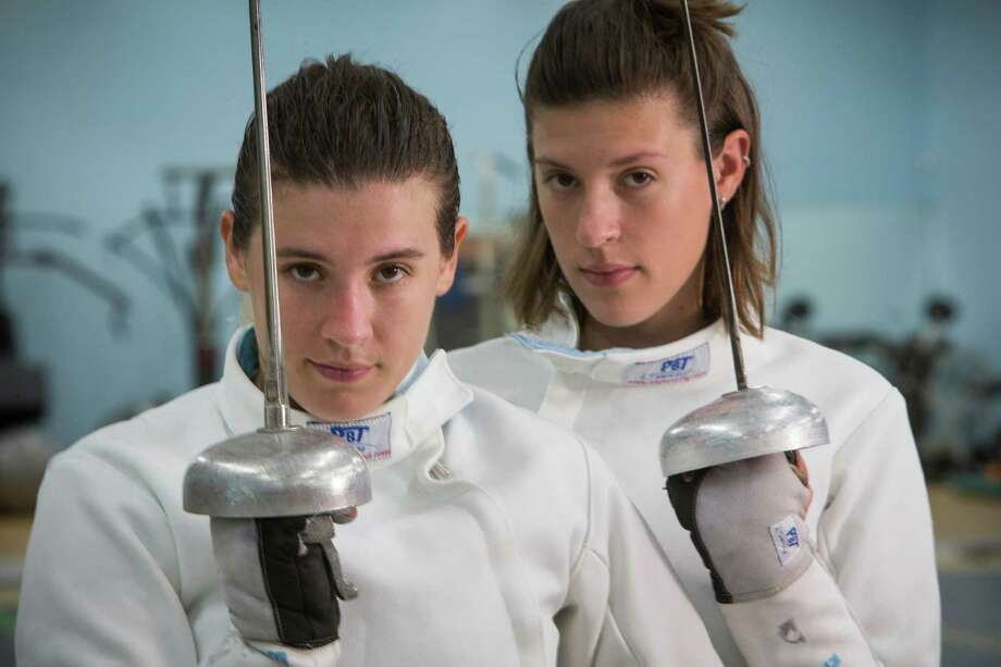 U.S. Olympic fencers Courtney Hurley, 25 (left) and her sister, Kelley, 28, pose for a portrait at Alliance Fencing Academy while preparing for the upcoming Rio Olympics on July 14, 2016, in Houston. Photo: Brett Coomer /Houston Chronicle / © 2016 Houston Chronicle