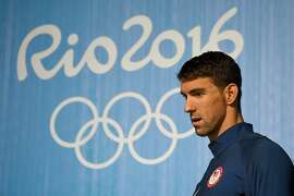 US swimmer Michael Phelps holds a press conference on August 3, 2016 in Rio de Janeiro, two days prior the opening ceremony of the Rio 2016 Olympic Games. Phelps will carry the United States flag at the opening ceremony for the Olympics in Rio, the US Olympic Committee said. / AFP PHOTO / Martin BUREAUMARTIN BUREAU/AFP/Getty Images