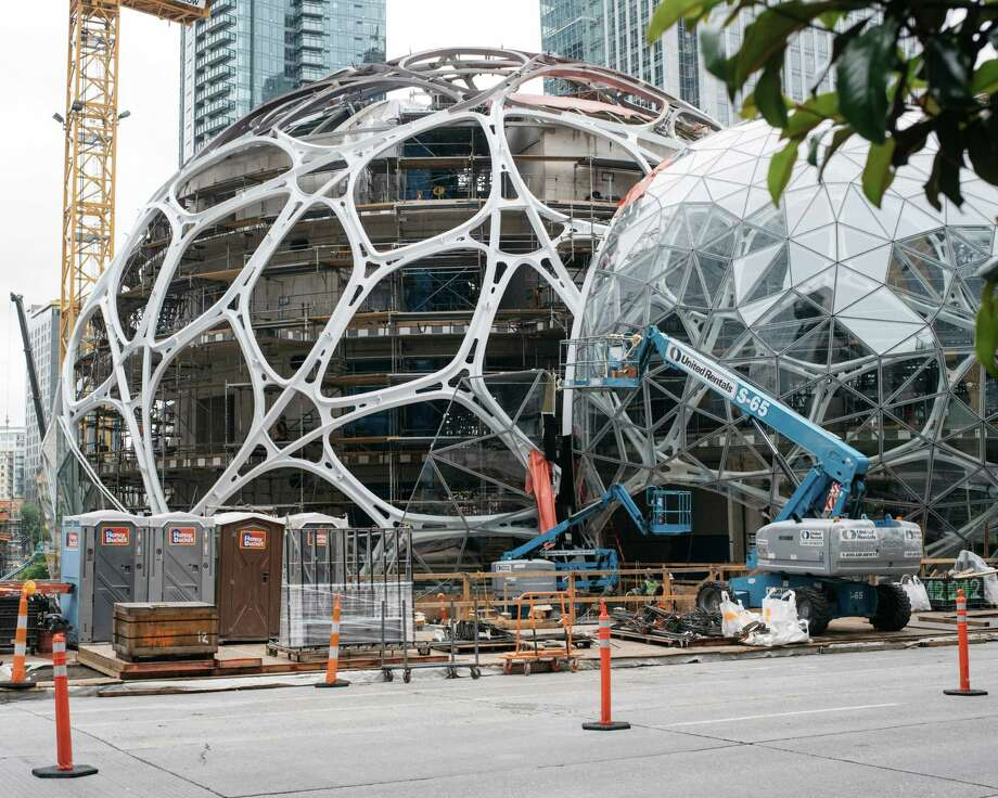 Jeff Bezos of Amazon — the spheres at Amazon in Seattle are show here — is among the entrepreneurs funding ambitious, varied efforts to make space more accessible. Photo: Ian C. Bates /New York Times / NYTNS