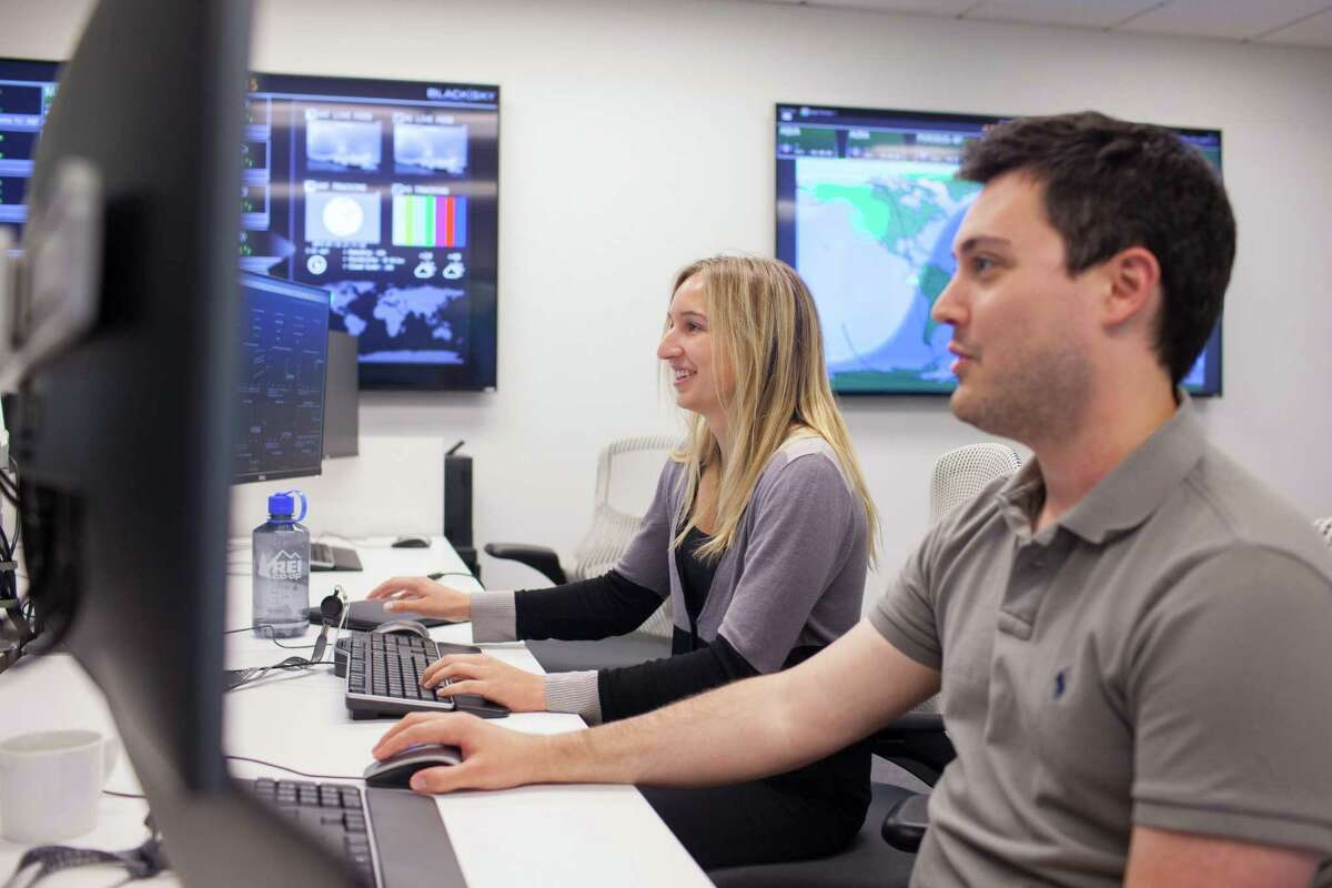 Engineers Micah Foster and Catherine Fitch work at Spaceflight Industries in Seattle, where software talent is helping draw commercial aerospace startups.