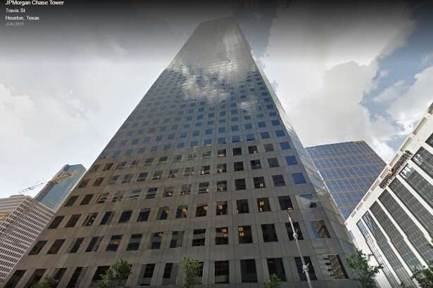 TALLEST BUILDING: JPMORGAN CHASE TOWER IN HOUSTON   Standing 1,002 feet tall, this 75-story skyscraper is located at 600 Travis Street in downtown Houston.
