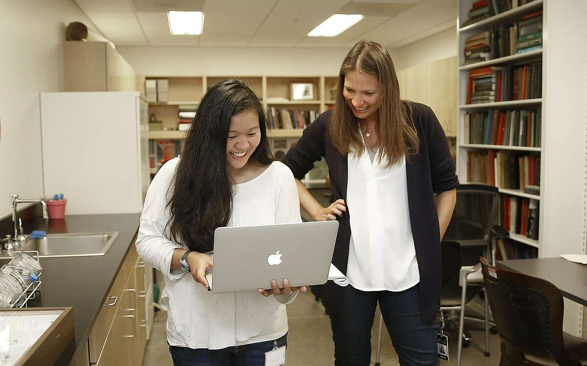 Entomologist Misha Leong (left) and research scientist Michelle Trautwein (right) look at comments of readers who saw their report about their study on indoor bug diversity published in the Gaurdian on Wednesday, August 3, 2016, in San Francisco, Calif.