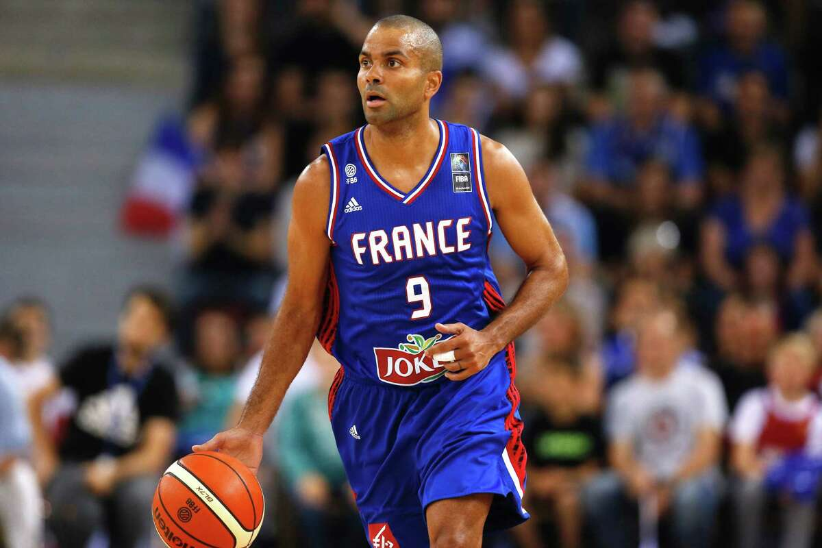 France's Tony Parker runs with the ball during the basketball match between France and Japan at the Kindarena hall in Rouen on June 28, 2016. / AFP PHOTO / CHARLY TRIBALLEAUCHARLY TRIBALLEAU/AFP/Getty Images