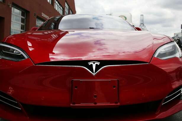 FILE - AUGUST 1, 2016: It was reported that Tesla Motors Inc. has reached a deal to buy SolarCity Corp. for $2.6 billion August 1, 2016. NEW YORK, NY - JULY 05:  A Tesla model S sits parked outside of a new Tesla showroom and service center in Red Hook, Brooklyn on July 5, 2016 in New York City. The electric car company and its CEO and founder Elon Musk have come under increasing scrutiny following a crash of one of its electric cars while using the controversial autopilot service. Joshua Brown crashed and died in Florida on May 7 in a Tesla car that was operating on autopilot, which means that Brown's hands were not on the steering wheel.  (Photo by Spencer Platt/Getty Images)