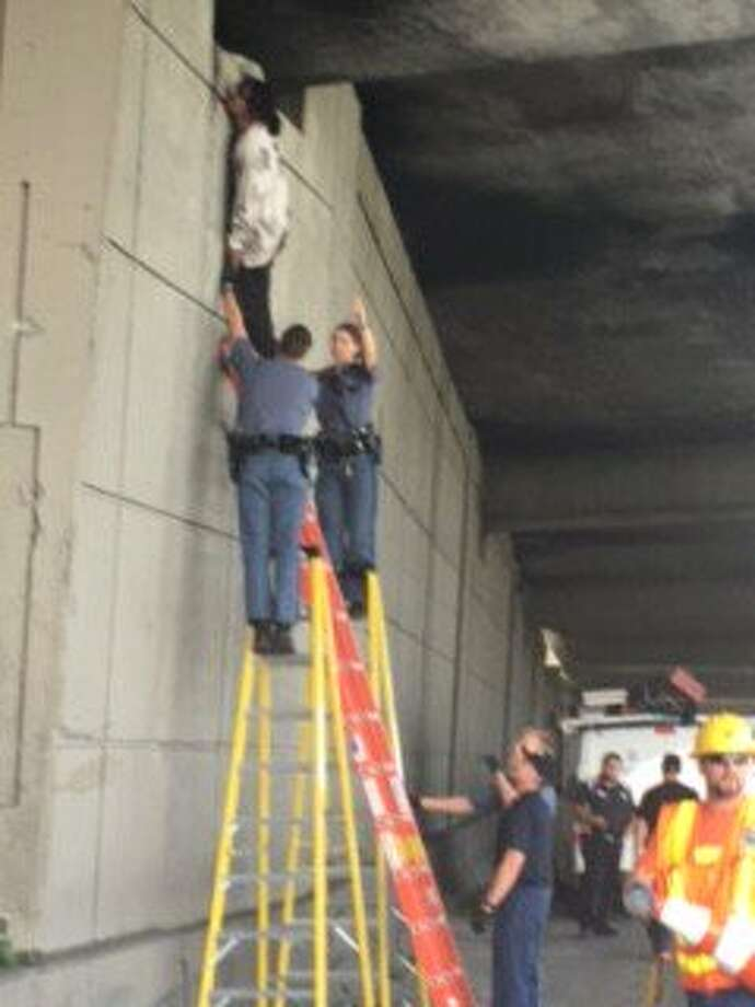 Witnesses help first responders rescue man hanging from I-90 bridge