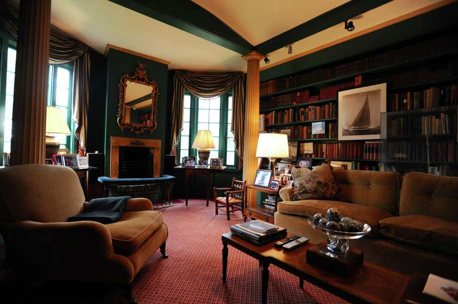 The television room, complete with full library and working fireplace, inside the $9 million home on Caritas Island which is on the market. Photographed on Tuesday, August 2, 2016. Photo: Michael Cummo / Hearst Connecticut Media / Stamford Advocate
