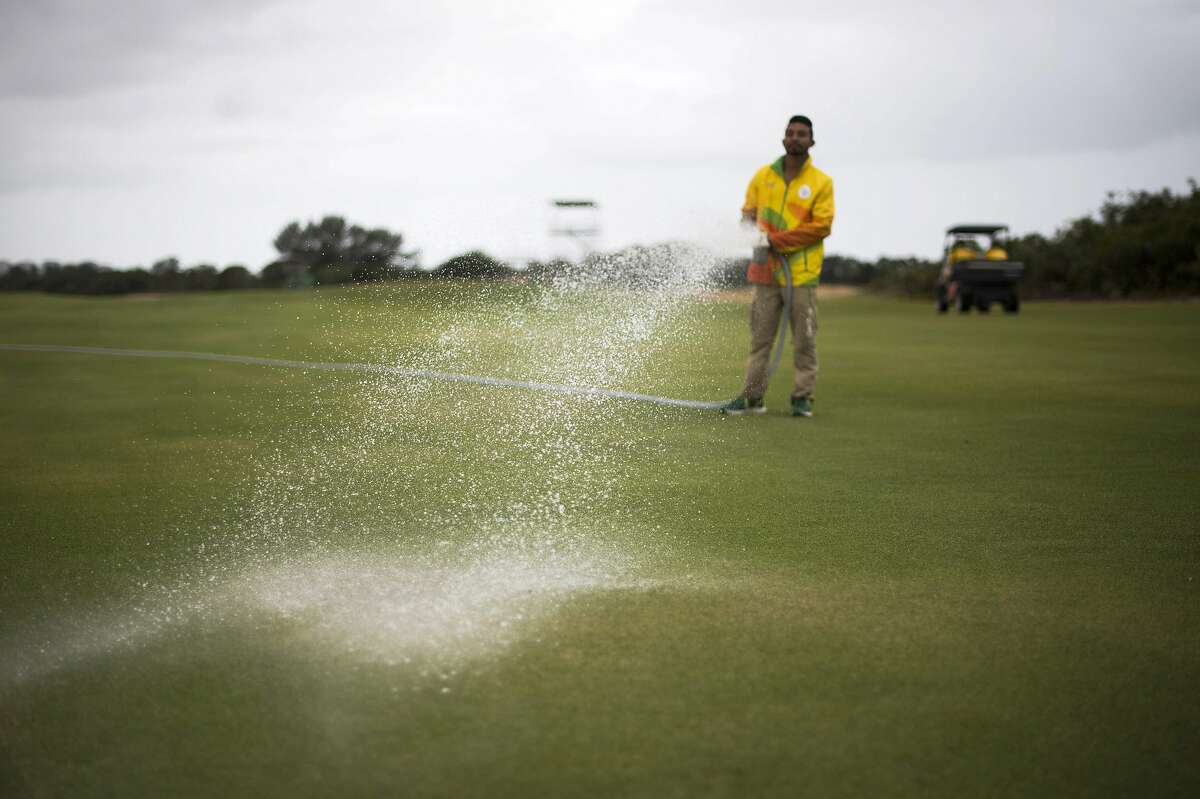 A groundsman waters a fairway on the Rio Olympic golf course, in Rio de Janeiro, on August 3, 2016, ahead of the Rio 2016 Olympic Games.