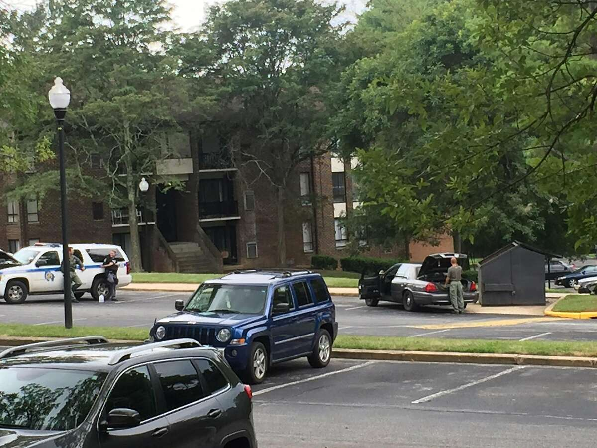 Authorities respond to the scene Randallstown, Md., Monday, Aug. 1, 2016. Baltimore County police say officers have shot and killed a woman who barricaded herself and a child inside a suburban Baltimore apartment and pointed a gun at them. (Maya Earls/The Baltimore Sun via AP)