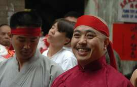 "In this photo taken Aug. 6, 2006, Raymond ""Shrimp Boy"" Chow is shown after being sworn in as the ""Dragon Head"" of the Chee Kung Tong in Chinatown in San Francisco. Investigators say Chow is the leader and the dragonhead of one of the most powerful Asian gangs in North America. Chow's gang is said to have lured state Sen. Leland Yee into its clutches through money and campaign contributions in exchange for legislative help, as Yee sought to build his campaign coffers to run for California secretary of state. Born in Hong Kong in 1960, Chow came to the United States at 16 and was reportedly nicknamed ""Shrimp Boy"" by his grandmother, in part due to his small stature. (AP Photo/Sing Tao Daily)"