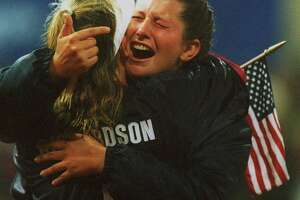 SOFTBALL - Christa Williams hugs teammate Dot Richardson after the US defeated Japan 2-1 in 8 innings to win the gold medal, 9/26/00, at the 2000 Olympic Games in Sydney.  (Smiley N. Pool/Chronicle)  HOUCHRON CAPTION (09/27/2000):  Christa Williams, right, hugs teammate Dot Richardson after defeating Japan 2-1 in eight innings to secure the gold Tuesday in Sydney.  The U.S. softball team had its 112-game winning streak snapped by Japan in the preliminary round.