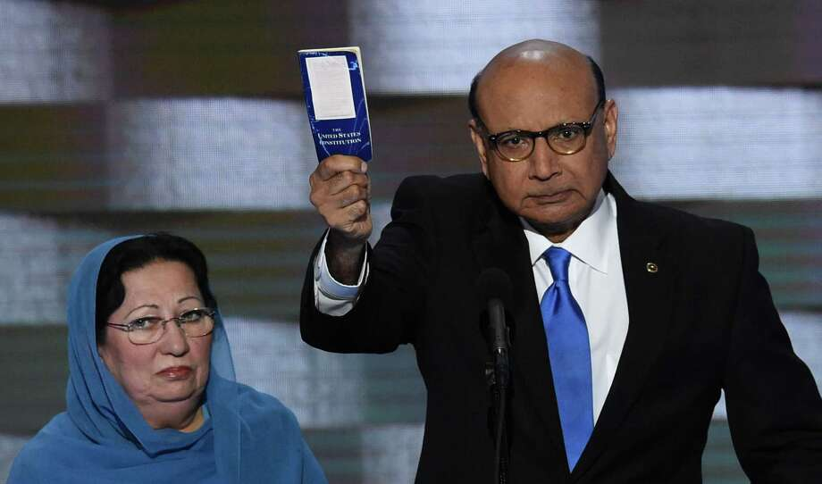 Khizr Khan holds his personal copy of the Constitution while addressing delegates at the Democratic National Convention. Readers disagree on the growing controversy between Khan and the man he condemned in his speech, Republican presidential candidate Donald Trump. Photo: SAUL LOEB /AFP /Getty Images / AFP or licensors
