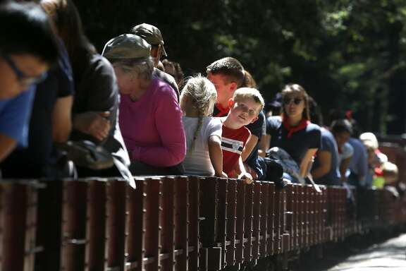 Passengers take their seats for a 1.2 mile ride through Tilden Park aboard the Redwood Valley Railway in Orinda, Calif. on Wednesday, Aug. 3, 2016.