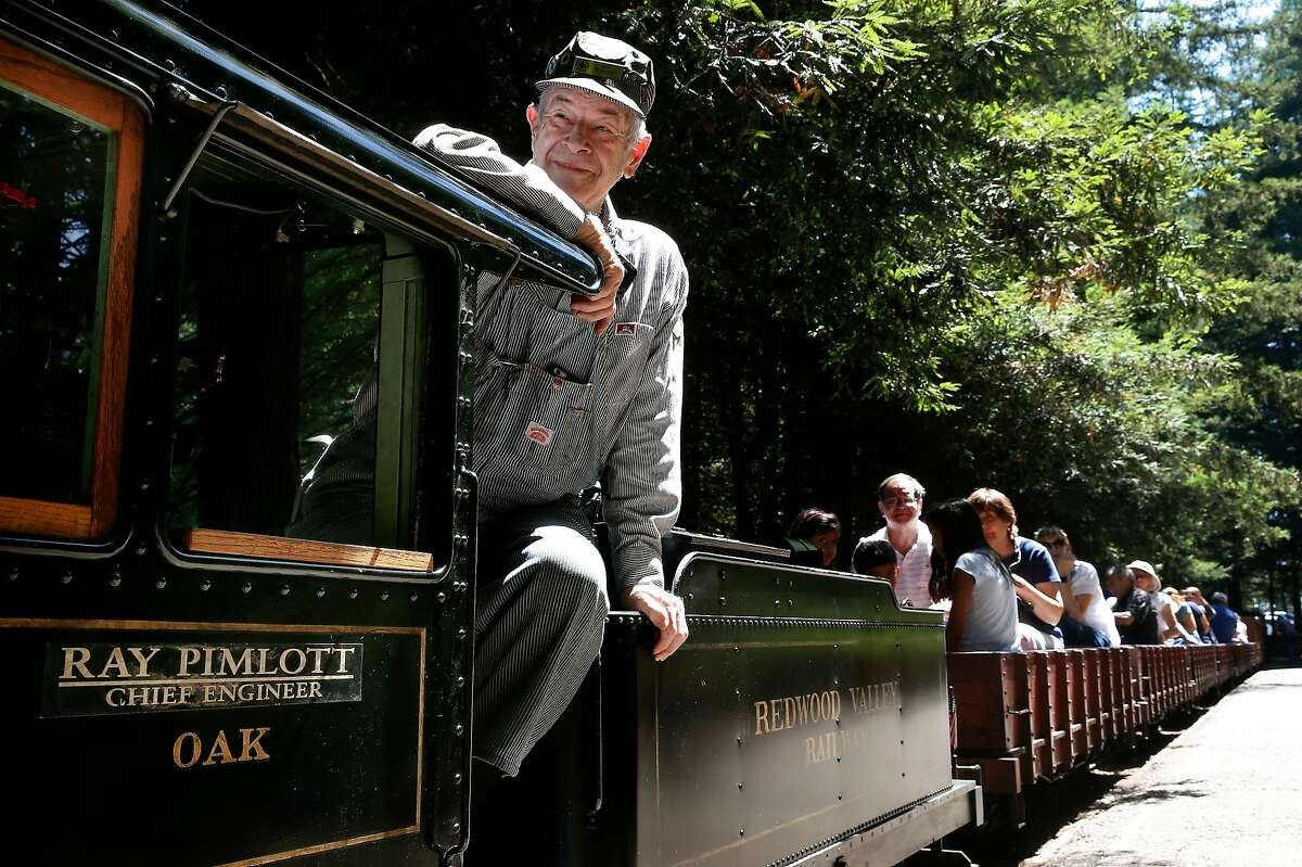 Chief Engineer Ray Pimlott picks up passengers for the 12-minute ride aboard the Redwood Valley Railway at Tilden Park in Orinda, Calif. on Wednesday, Aug. 3, 2016.