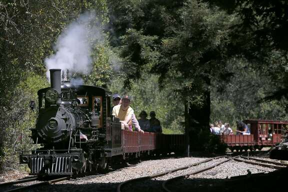 "The No. 7 ""Oak"" steam locomotive leads passengers on a 1.2 mile ride aboard the Redwood Valley Railway through Tilden Park in Orinda, Calif. on Wednesday, Aug. 3, 2016."