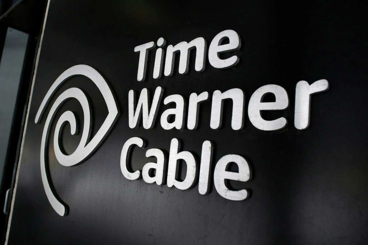 FILE - In this May 26, 2015, file photo, the Time Warner Cable corporate logo is displayed at a company store, in New York. Time Warner is taking a 10 percent stake in streaming television service Hulu, announced Wednesday, Aug. 3, 2016. In addition, networks such as TNT, TBS, CNN and Cartoon Network will be available live and on-demand on the live-streaming service that Hulu?'s expected to launch next year. (AP Photo/Mark Lennihan, File) ORG XMIT: NY108