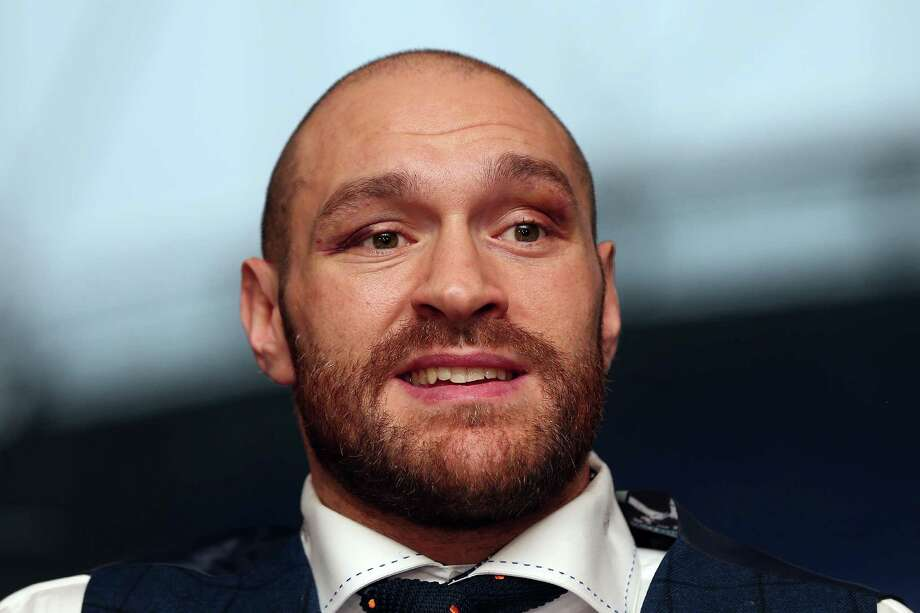 BOLTON, ENGLAND - NOVEMBER 30: Tyson Fury speaks at a press conference at the Macron Stadium on November 30, 2015 in Bolton, England. (Photo by Chris Brunskill/Getty Images) ORG XMIT: 594092019 Photo: Chris Brunskill / 2015 Getty Images