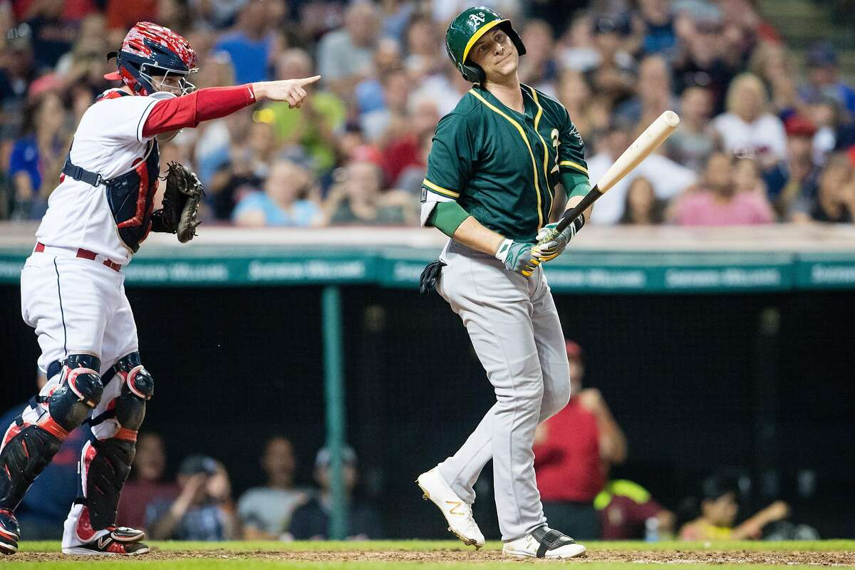 CLEVELAND, OH - JULY 29: Catcher Roberto Perez #55 of the Cleveland Indians and Jed Lowrie #8 of the Oakland Athletics react after Lowrie struck out during the ninth inning at Progressive Field on July 29, 2016 in Cleveland, Ohio. The Indians defeated the Athletics 5-3. (Photo by Jason Miller/Getty Images)