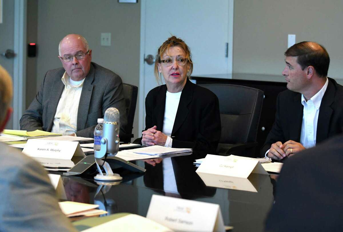 Karen A. Murphy, center, starts the Fuller Road Management Corporation Board of Directors meeting on Wednesday Aug. 3, 2016 in Albany, N.Y. (Michael P. Farrell/Times Union)