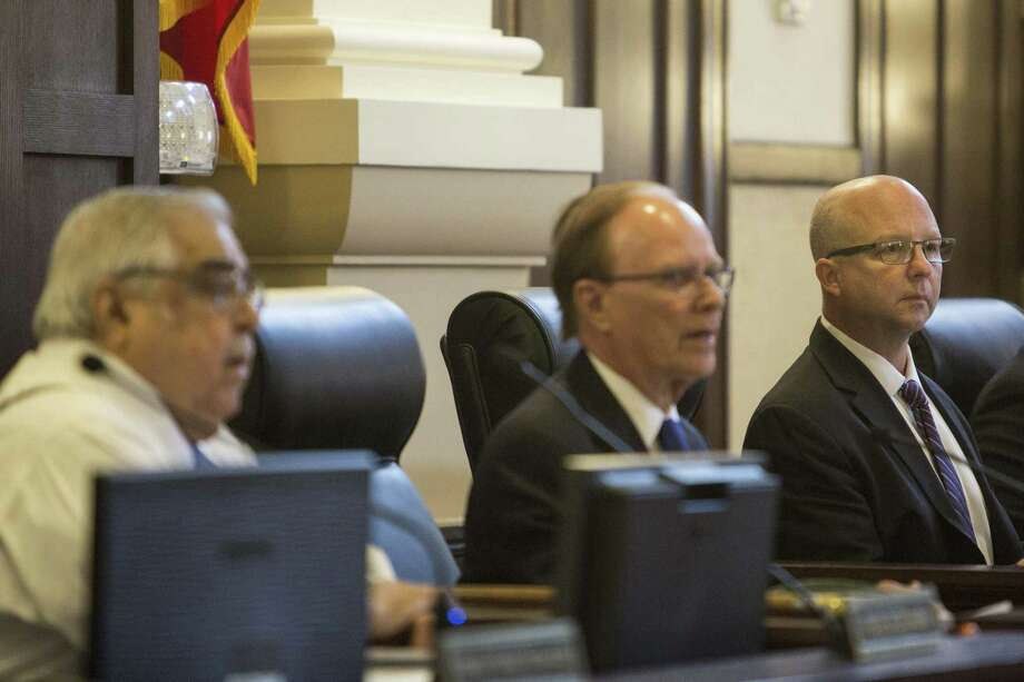 Bexar County Commissioners Court has made bold moves to trim bureaucracy. Here, Precinct 3 Commissioner Kevin Wolff sits next to County Judge Nelson Wolff during a meeting at the Bexar County Courthouse on Aug. 3, 2016. Photo: Carolyn Van Houten /Carolyn Van Houten / 2016 San Antonio Express-News
