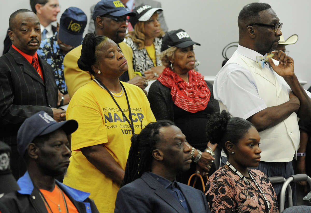 Members of the NAACP and others listen to testimony as Alabama's parole board considers whether to release convicted church bomber Thomas Blanton Jr. during a hearing Wednesday.