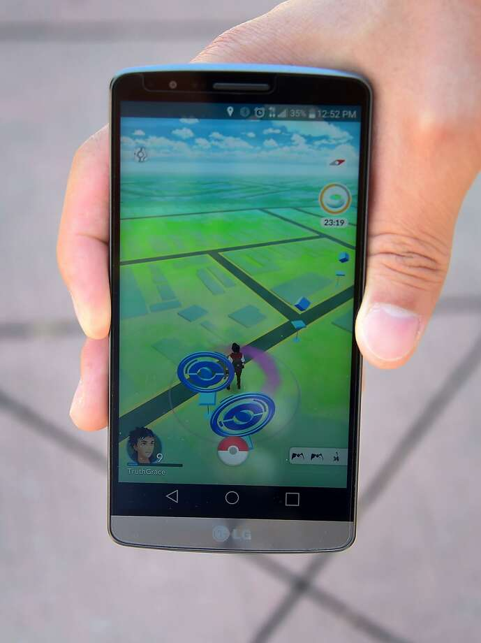 (FILES) This file photo taken on July 13, 2016 shows a cellphone screen shows the game Pokemon Go in San Gabriel, California. It's the smartphone game electrifying the world but New York took steps Monday to ban sex offenders from using the app to potentially prey on child victims. The game, developed by US-based software company Niantic, a spinoff of Google, has been downloaded more than 75 million times across the United States and has gone viral across the world.But Governor Andrew Cuomo ordered New York's department of corrections to ban nearly 3,000 registered offenders on parole from downloading, accessing or taking part in Pokemon Go as well as other Internet-enabled games.  / AFP PHOTO / Frederic J. BROWNFREDERIC J. BROWN/AFP/Getty Images Photo: FREDERIC J. BROWN, AFP/Getty Images