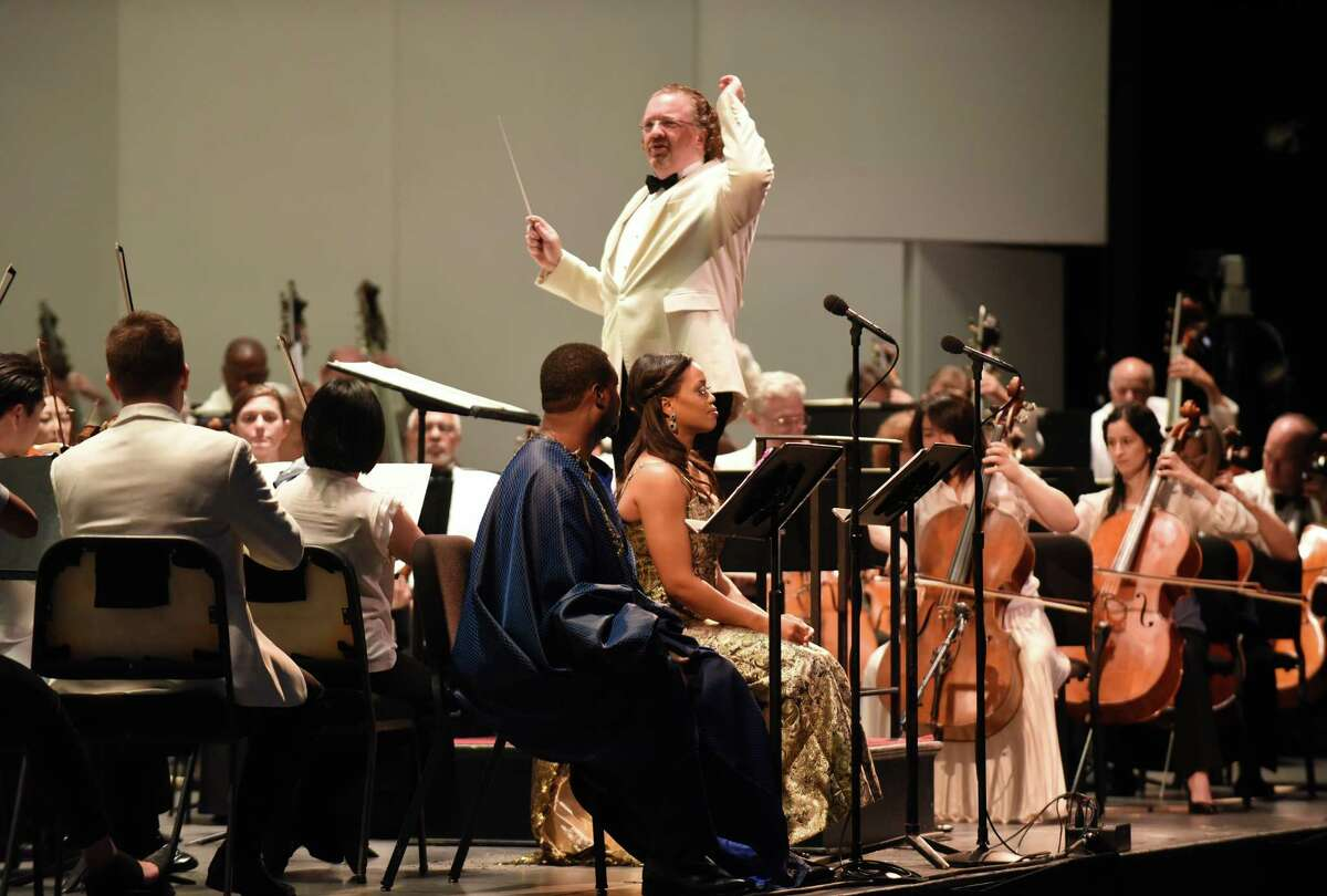 Conductor Stéphane Deneve, center, leads the Philadelphia Orchestra opening night featuring Albany Pro Musica and the Morgan State University Choir at SPAC on Wednesday Aug. 3, 2016 in Saratoga Springs, N.Y. (Michael P. Farrell/Times Union)