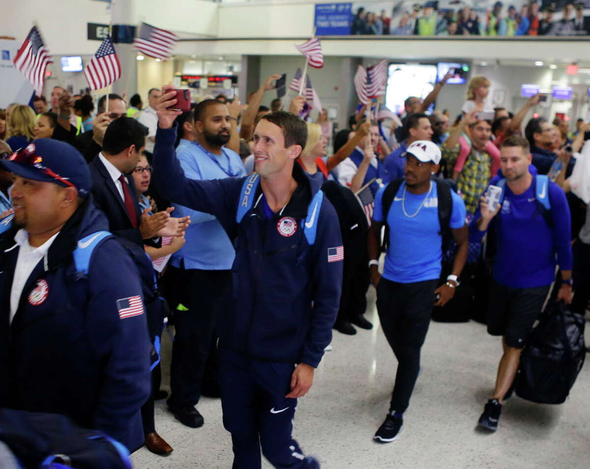Team USA athletes board their flight to Rio at Bush Intercontinental Airport, Wednesday, Aug. 3, 2016, in Houston. United is a sponsor for Team USA and expects to fly 1300 athletes, coaches and team staff to Rio for the Olympic and Paralympic games.