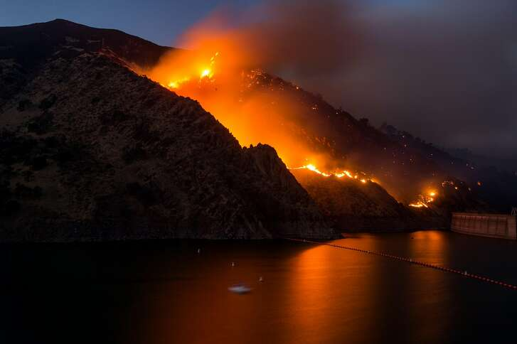 The Cold Fire burns above Lake Berryessa and the Monticello Dam on Wednesday, Aug. 3, 2016, near Winters, Calif.