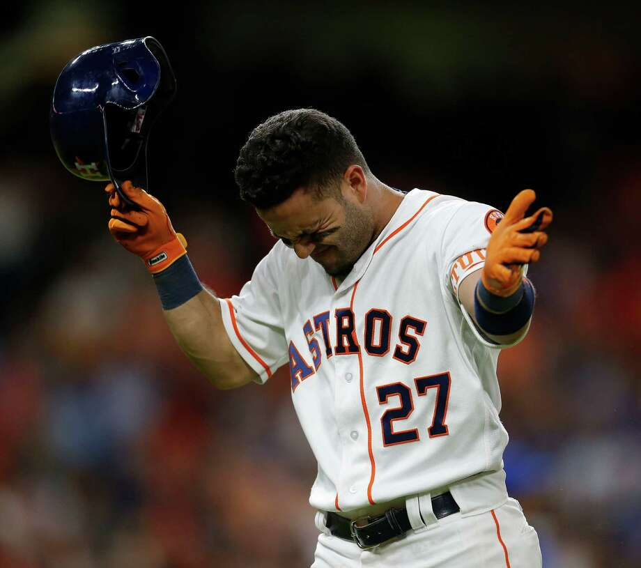 Jose Altuve lets his frustration show after flying out with two men in scoring position in the eighth inning Wednesday night. Photo: Karen Warren, Staff / © 2016 Houston Chronicle