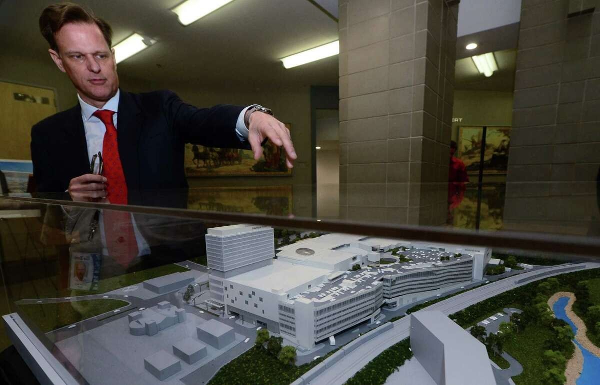 General Growth Properties executive Doug Adams points out details in June 2016 of the planned SoNo Collection mall in Norwalk, Conn. General Growth Properties CEO Sandeep Mathrani said in early August the project remains on track to begin construction in late 2016 or early 2017.