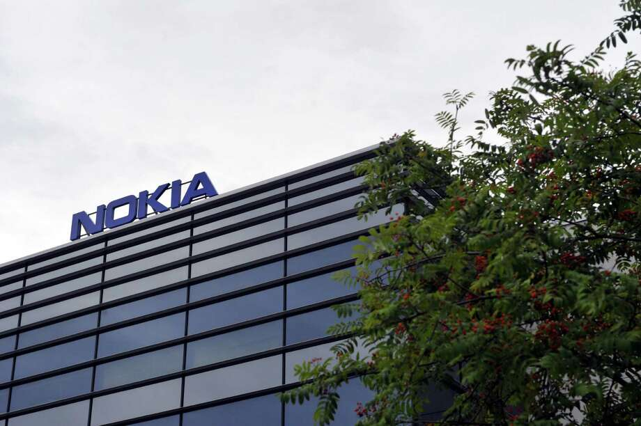 Nokia, facing intense competition from Ericsson AB and Huawei Technologies Co., spent about $18 billion for Alcatel to expand beyond mobile infrastructure, pledging to wring cost savings out of the combined operation. Photo: IRENE STACHON /AFP /Getty Images / AFP or licensors