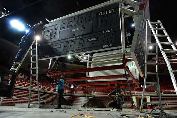 Workers on Wednesday remove the Montagne Center's scoreboard, which was installed in 1985 when the Lamar University athletic facility opened, to make room for an updated version. The new scoreboard, which will include video screens, is expected to be installed next month, said James Dixon, the Cardinal's Sports Information Director. Dixon said the new scoreboard will  help the basketball teams remain competitive during recruitment. Photo taken Wednesday, August 03, 2016 Guiseppe Barranco/The Enterprise